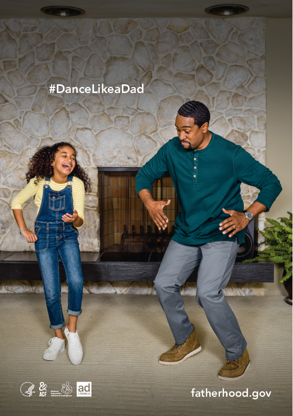 Dad and daughter dancing in living room